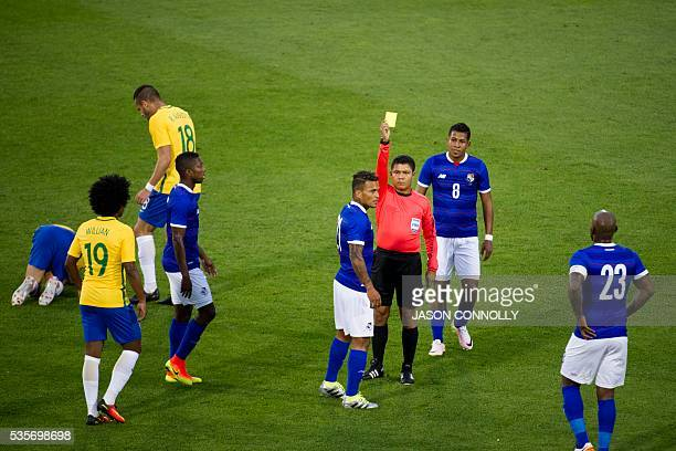 Amilcar Henriquez of Panama receives a yellow card from the referee during an international friendly match at Dick's Sporting Goods Park in Commerce...