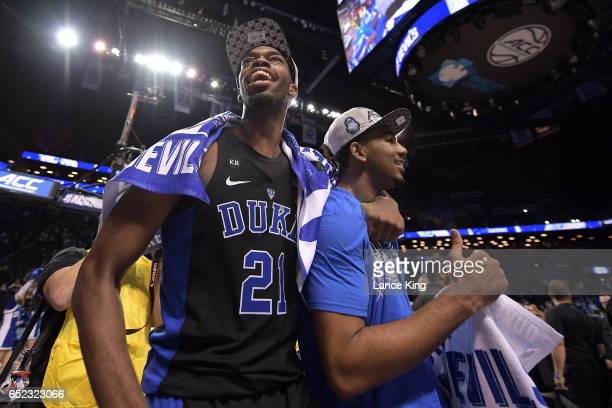 Amile Jefferson and Matt Jones of the Duke Blue Devils celebrate following their 7569 victory against the Notre Dame Fighting Irish during the ACC...
