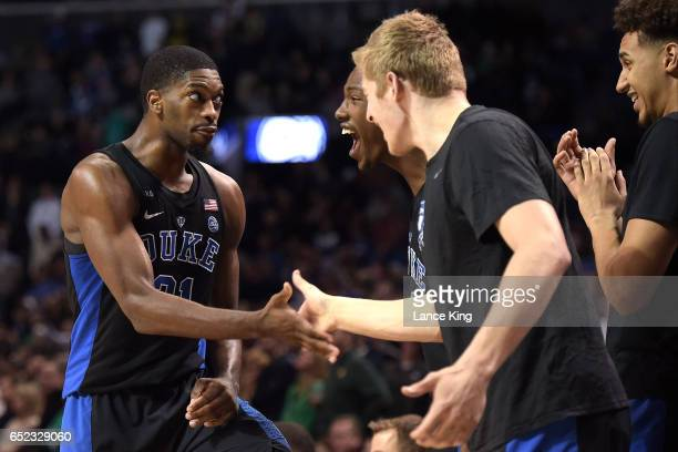 Amile Jefferson Harry Giles Jack White and Chase Jeter of the Duke Blue Devils celebrate near the end of their game against the Notre Dame Fighting...