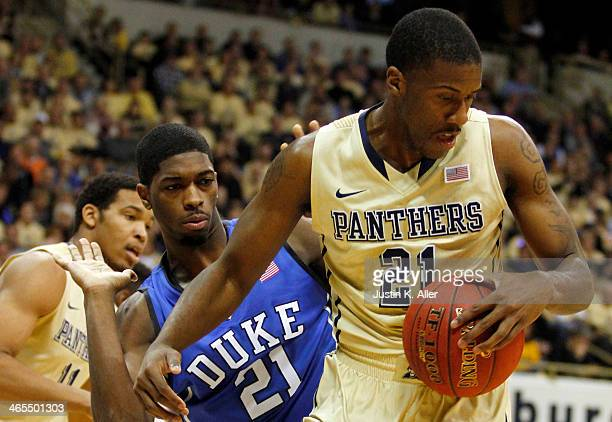 Amile Jefferson of the Duke Blue Devils and Lamar Patterson of the Pittsburgh Panthers battle for a rebound at Petersen Events Center on January 27...