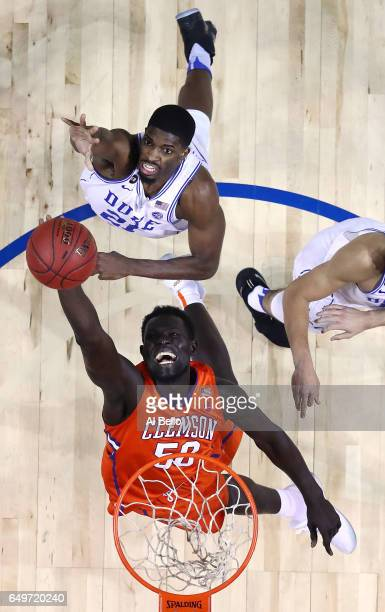 Amile Jefferson of the Duke Blue Devils and Sidy Djitte of the Clemson Tigers battle for the ball during the second round of the ACC Basketball...