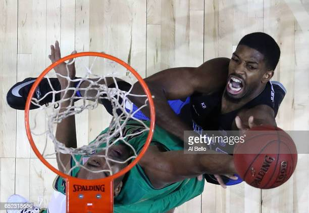 Amile Jefferson of the Duke Blue Devils battles against Bonzie Colson of the Notre Dame Fighting Irish during the championship game of the 2017 Men's...