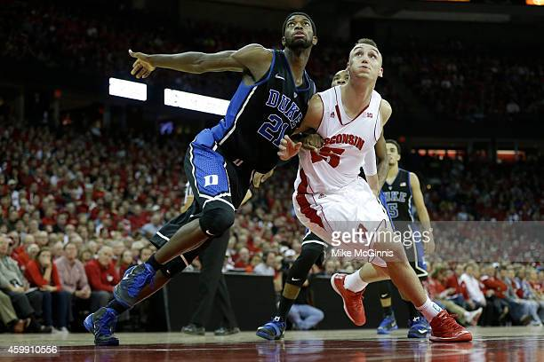 Amile Jefferson of the Duke Blue Devils boxes out Sam Dekker of the Wisconsin Badgers for the rebound during the second half at Kohl Center on...