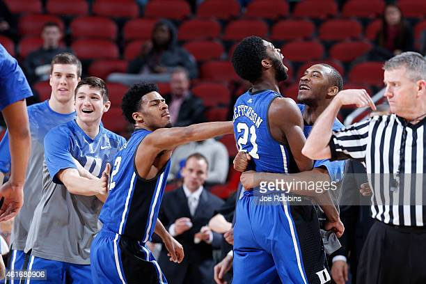 Amile Jefferson of the Duke Blue Devils celebrates with teammates Quinn Cook and Rasheed Sulaimon after making a basket against the Louisville during...