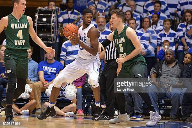 Amile Jefferson of the Duke Blue Devils moves the ball against Greg Malinowski of the William Mary Tribe at Cameron Indoor Stadium on November 23...