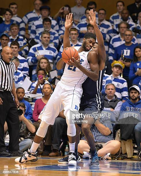 Amile Jefferson of the Duke Blue Devils moves the ball against Justin Sears of the Yale Bulldogs at Cameron Indoor Stadium on November 25 2015 in...