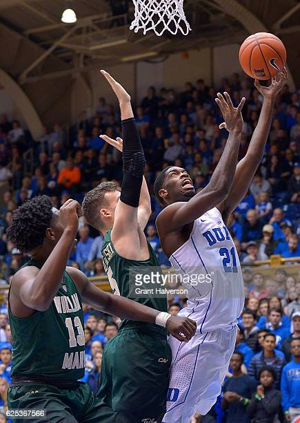 Amile Jefferson of the Duke Blue Devils shoots over Greg Malinowski of the William Mary Tribe during the game at Cameron Indoor Stadium on November...