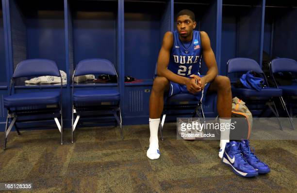 Amile Jefferson of the Duke Blue Devils sits in the locker room dejected after they lost to the Louisville Cardinals 8563 during the Midwest Regional...