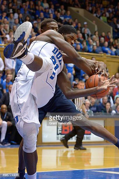 Amile Jefferson of the Duke Blue Devils tangles with Justin Sears of the Yale Bulldogs as they battle for the ball during their game at Cameron...
