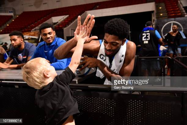 Amile Jefferson of the Lakeland Magic celebrates with a young fan after the game against the Westchester Knicks on November 10 2018 at RP Funding...