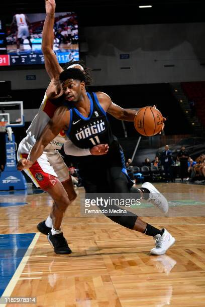 Amile Jefferson of the Lakeland Magic drives against Tahjere McCall of the College Park Skyhawks during the game on November 16, 2019 at RP Funding...