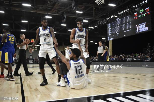 Amile Jefferson of the Lakeland Magic is helped up by his teammates against the Santa Cruz Warriors during the NBA G League Winter Showcase on...