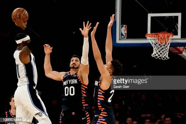 Amile Jefferson of the Orlando Magic shoots against defense from Enes Kanter and Kevin Knox of the New York Knicks during the game at Madison Square...