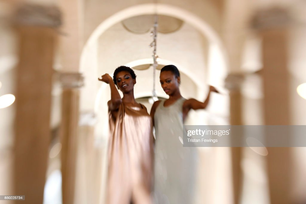 Amilna Estevao and Mayowa Nicholas are seen backstage ahead of the Alberta Ferretti show during Milan Fashion Week Spring/Summer 2018on September 20, 2017 in Milan, Italy.