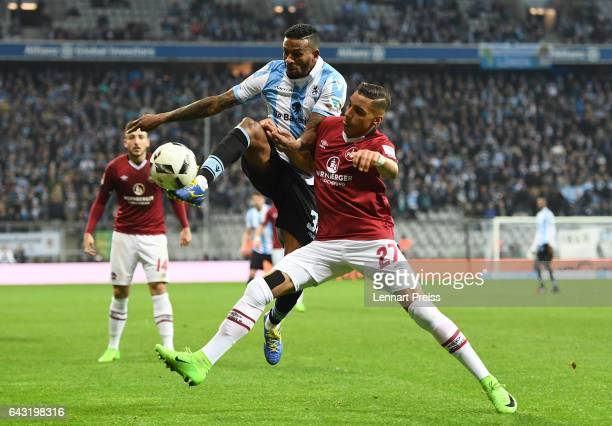 Amilton of TSV 1860 Muenchen challenges Abdelhamid Sabiri of 1 FC Nuernberg during the Second Bundesliga match between TSV 1860 Muenchen and 1 FC...