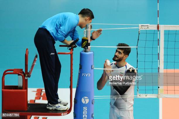 Amin Esmaeilnejad of Iran protests during the 19th Asian Senior Men's Volleyball Championship quarterfinal match between Indonesia and Iran at GOR...