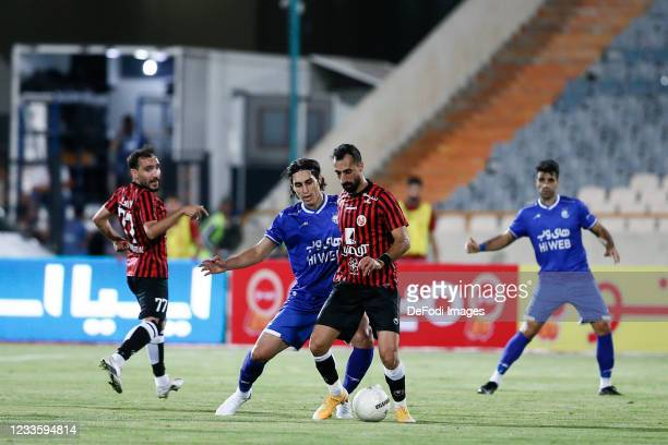 Amin Ghaseminejad of Padideh and Mohammad Naderi of Esteghlal battle for the ball during the Persian Gulf Pro League match between Esteghlal and...
