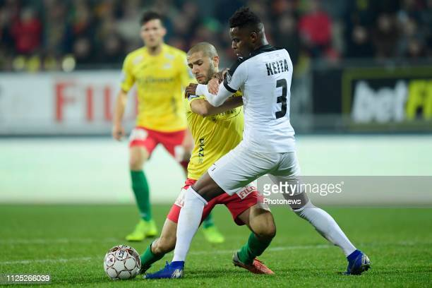 Amin Nouri midfielder of Oostende is fighting for the ball with Cheick Keita defender of Eupen during the Jupiler Pro League match between KV...