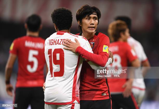 Amin Tighazoui of Wydad Casablanca shakes hands with Yosuke Kashiwagi of Urawa Reds after the FIFA Club World Cup UAE 2017 fifth place playoff match...
