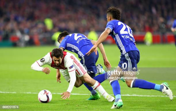 Amin Younes of Ajax is fouled by Alessandro Schopf of FC Schalke 04 leading to a penalty scored by Davy Klaassen during the UEFA Europa League...