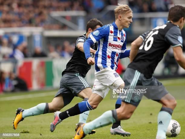 Amin Younes of Ajax Martin Odegaard of sc Heerenveen Nick Viergever of Ajax during the Dutch Eredivisie match between sc Heerenveen and Ajax...