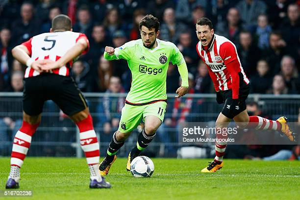 Amin Younes of Ajax runs on goal and shoots in front of Jeffrey Bruma of PSV during the Eredivisie match between PSV Eindhoven and Ajax Amsterdam...