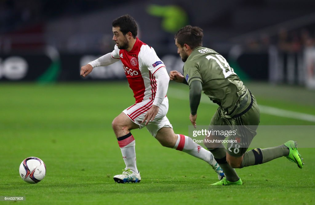 Amin Younes of Ajax takes on Lukasz Broz of Legia Warszawa during the UEFA Europa League Round of 32 second leg match between Ajax Amsterdam and Legia Warszawa at Amsterdam Arena on February 23, 2017 in Amsterdam, Netherlands.