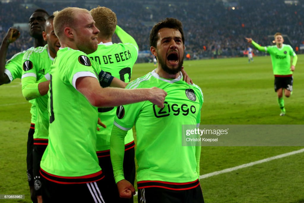 Amin Younes of Amsterdam (R) celebrates the second goal with Davy Klaassen of Amsterdam (L) during the UEFA Europa League quarter final second leg match between FC Schalke 04 and Ajax Amsterdam at Veltins-Arena on April 20, 2017 in Gelsenkirchen, Germany.