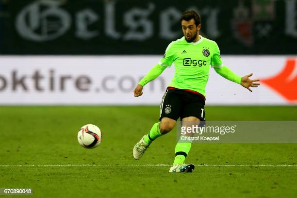 Amin Younes of Amsterdam runs with the ball during the UEFA Europa League quarter final second leg match between FC Schalke 04 and Ajax Amsterdam at...