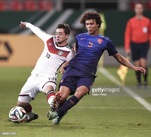 Amin Younes of Germany challenges Nathan Ake of the Netherlands during the U21 Germany v U21 Netherlands International Friendly match at Audi...