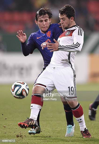 Amin Younes of Germany is challenged by Joris van Overeem of the Netherlands during the U21 Germany v U21 Netherlands International Friendly match at...