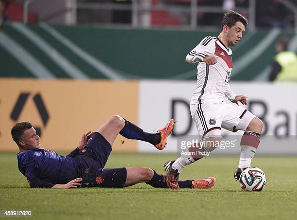 Amin Younes of Germany is tackled during the U21 Germany v U21 Netherlands International Friendly match at Audi Sportpark on November 13, 2014 in...