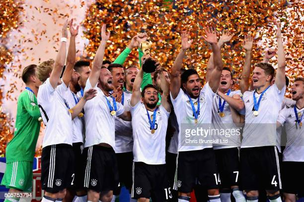 Amin Younes of Germany lifts the FIFA Confederations Cup trophy after the FIFA Confederations Cup Russia 2017 Final match between Chile and Germany...