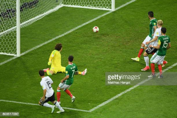 Amin Younes of Germany scores his side's fourth goal past Guillermo Ochoa of Mexico during the FIFA Confederations Cup Russia 2017 SemiFinal between...
