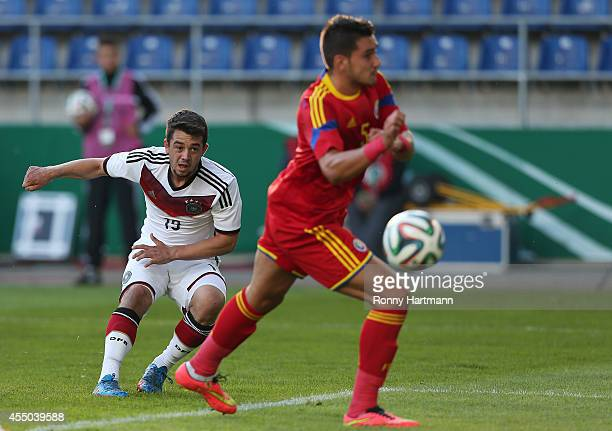 Amin Younes of Germany scores his team's third goal against Deian Boldor of Romania during the Under 21 Qualifier between Germany U21 and U21 Romania...