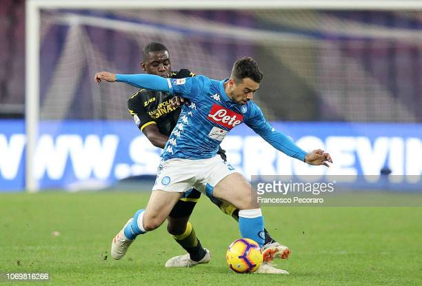 Amin Younes of SSC Napoli vies Joel Campbell of Frosinone Calcio during the Serie A match between SSC Napoli and Frosinone Calcio at Stadio San Paolo...