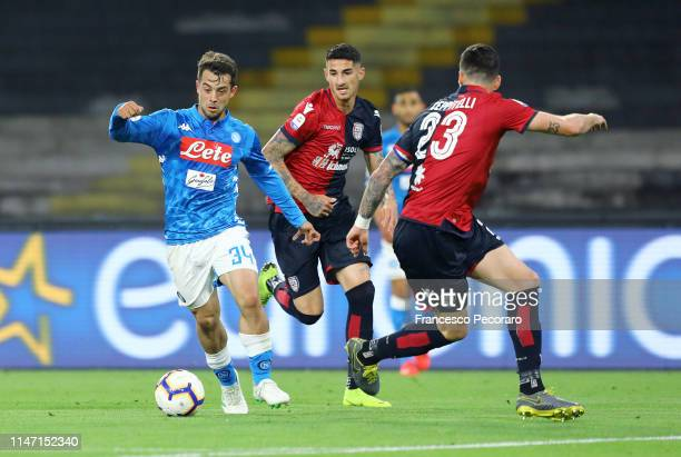 Amin Younes of SSC Napoli vies with Luca Ceppitelli during the Serie A match between SSC Napoli and Cagliari at Stadio San Paolo on May 05 2019 in...