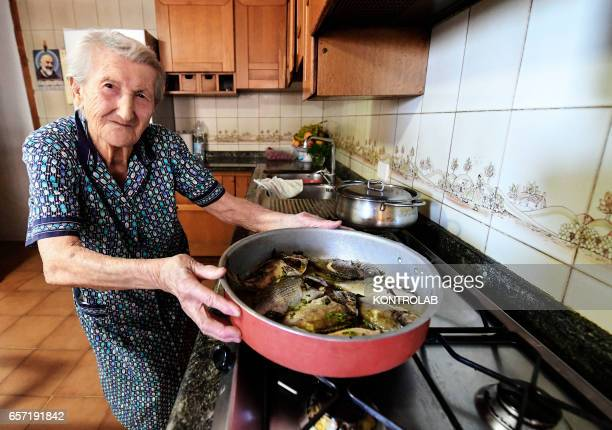 Amina Fedollo pose in their house while cooking fish in Acciaroli southern Italy Situated on the western coast of southern Italy the town of...