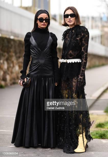 Amina Mauddi and Giorgia Tordini are seen outside the Loewe show during Paris Fashion Week: AW20 on February 28, 2020 in Paris, France.