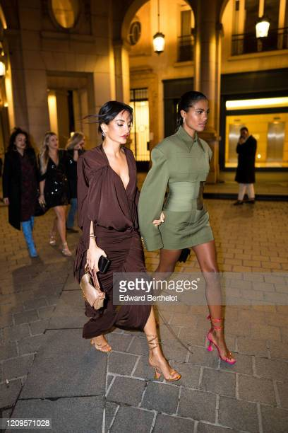 Amina Muaddi and Tina Kunakey are seen outside the MyTheresa x Amina Muaddi dinner at Froufrou Place Edouard VII during Paris Fashion Week Womenswear...