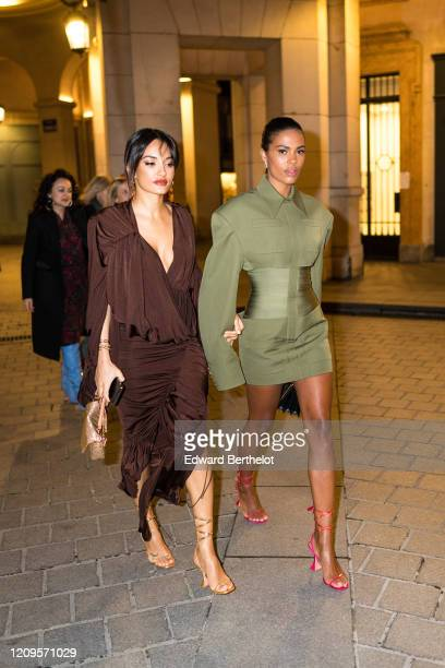 Amina Muaddi and Tina Kunakey are seen, outside the MyTheresa x Amina Muaddi dinner at Froufrou Place Edouard VII, during Paris Fashion Week -...