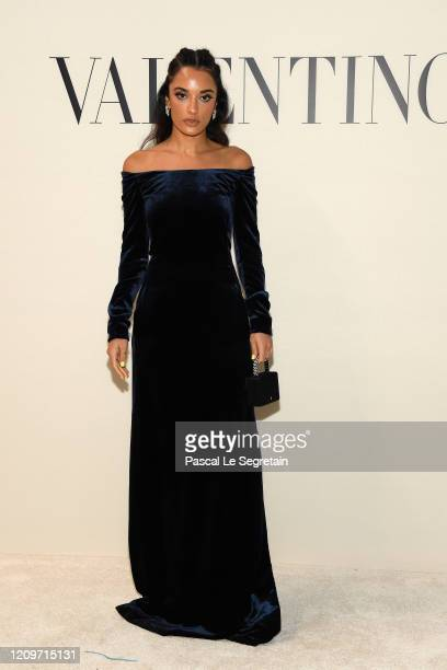 Amina Muaddi attends the Valentino show as part of the Paris Fashion Week Womenswear Fall/Winter 2020/2021 on March 01 2020 in Paris France