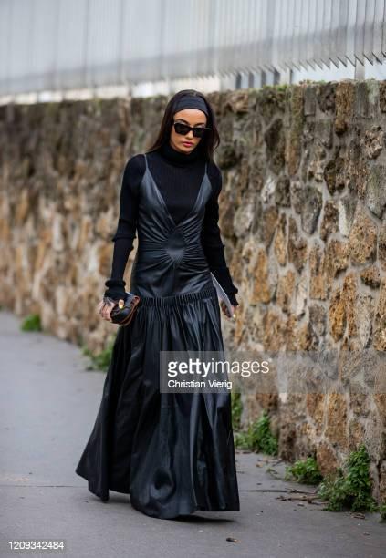 Amina Muaddi is seen wearing black leather dress turtleneck outside Loewe during Paris Fashion Week Womenswear Fall/Winter 2020/2021 Day Five on...