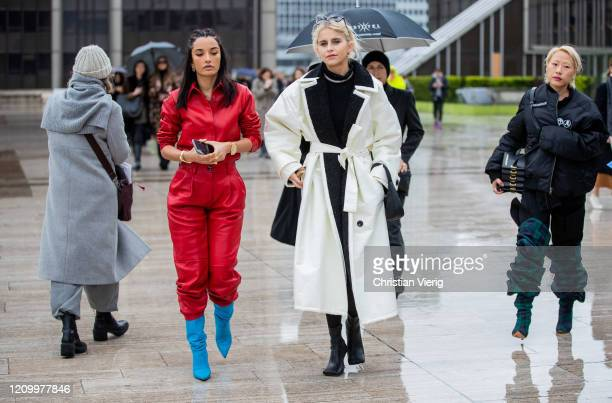 Amina Muaddi is seen wearing red pants and button shirt and Caroline Caro Daur is seen wearing white coat Prada bag outside Y/Project during Paris...