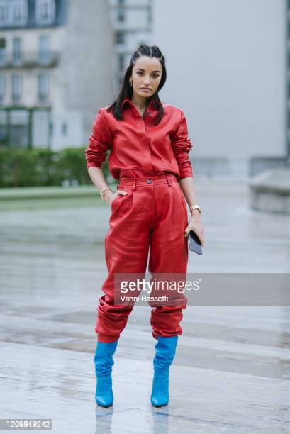 Amina Muaddi poses after the Y/Project show during Paris Fashion Week Womenswear Fall/Winter 2020/2021 on March 02 2020 in Paris France