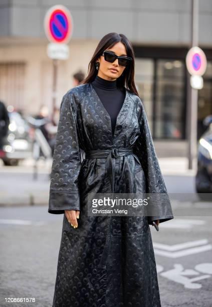 Amina Muaddi seen wearing black coat outside Marine Serre during Paris Fashion Week Womenswear Fall/Winter 2020/2021 Day Two on February 25 2020 in...