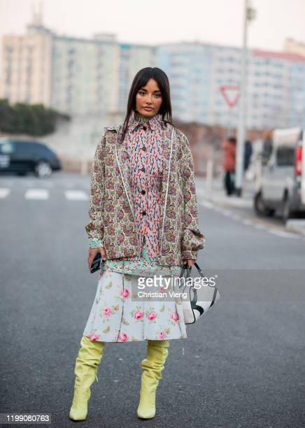 Amina Muaddi wearing mixed pattern seen outside Prada during Milan Fashion Week Fall/Winter 2020/2021 on January 12, 2020 in Milan, Italy.