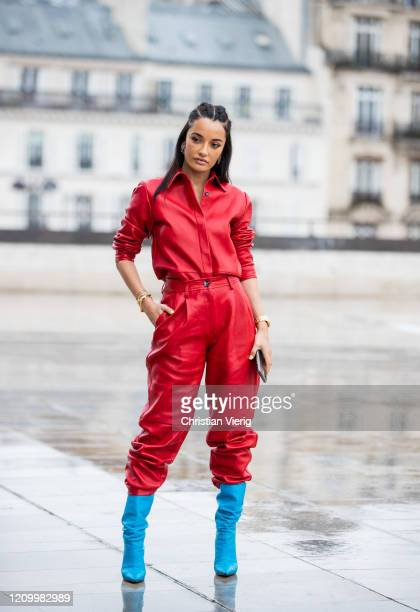 Amina Muaddi wearing red button shirt and pants seen outside Y/Project during Paris Fashion Week Womenswear Fall/Winter 2020/2021 Day Eight on March...