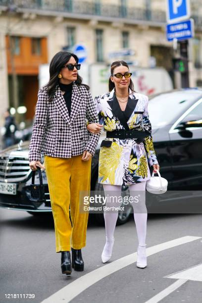 Amina Muaddi wears sunglasses a black top a black and white houndstooth doublebreasted jacket yellow corduroy pants a black Chanel bag black platform...