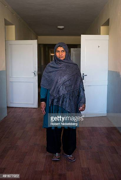 Amina Sajadi, 27 years, sits in an office at Marastoon, a government-funded institution that houses war widows and those without any family support...